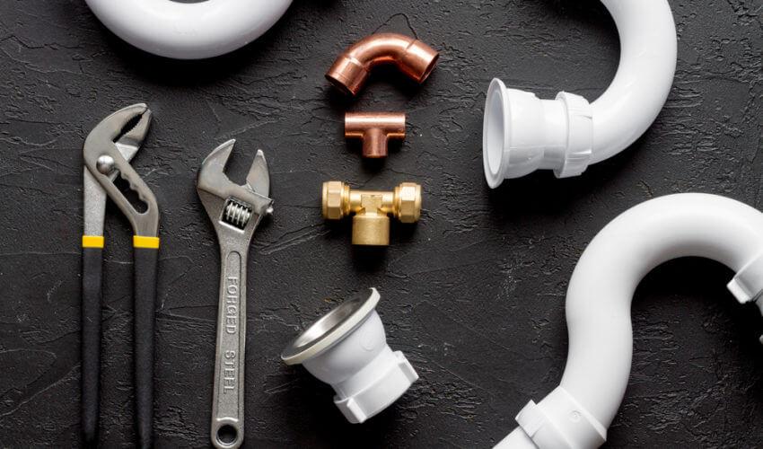 plumbing tools flat lay image