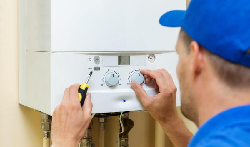 Engineer installing boiler